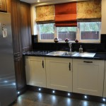 Shaker Vinyl Ivory & Dark Walnut with Gloss Laminate Worktops.