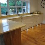 Odyssey Cream Gloss Kitchen with Solid Oak End Panels & Beige Starlight Quartz